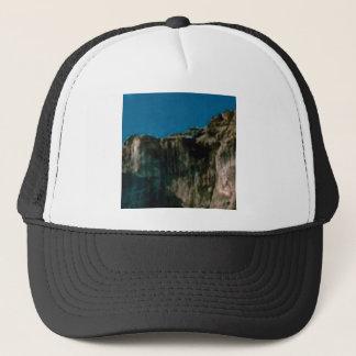 blue sky rock cliffs trucker hat