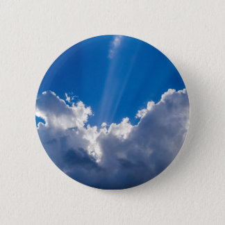 Blue sky with white clouds and ray of sunshine. 6 cm round badge