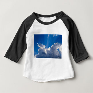 Blue sky with white clouds and ray of sunshine. baby T-Shirt