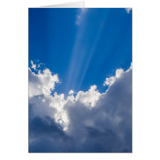 Blue sky with white clouds and ray of sunshine. card