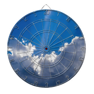 Blue sky with white clouds and ray of sunshine. dartboard