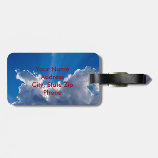 Blue sky with white clouds and ray of sunshine. luggage tag