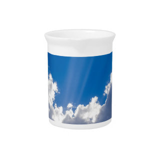 Blue sky with white clouds and ray of sunshine. pitcher