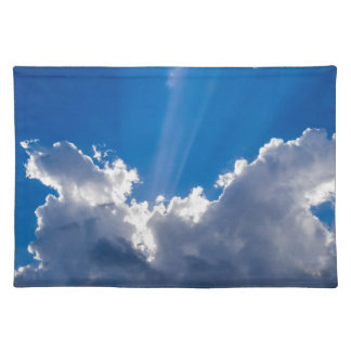 Blue sky with white clouds and ray of sunshine. placemat