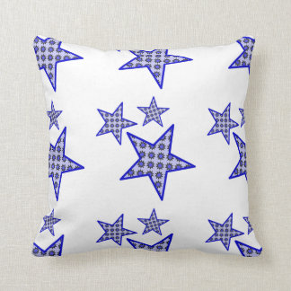 Blue star flowers on white in pattern on cushion