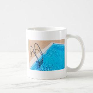 Blue swimming pool with ladder coffee mug