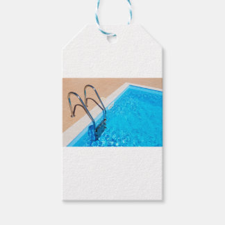 Blue swimming pool with ladder gift tags
