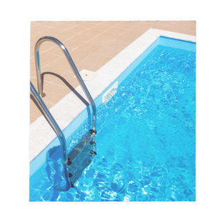 Blue swimming pool with ladder notepad