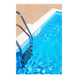 Blue swimming pool with ladder stationery