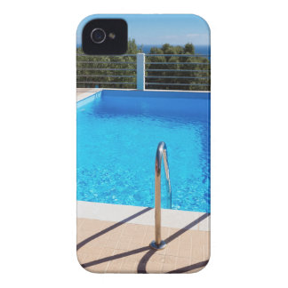 Blue swimming pool with steps at sea Case-Mate iPhone 4 cases