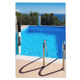 Blue swimming pool with steps at sea Dry-Erase whiteboards