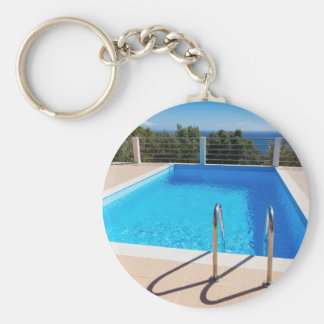 Blue swimming pool with steps at sea key ring
