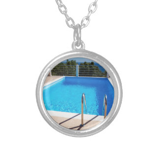 Blue swimming pool with steps at sea silver plated necklace