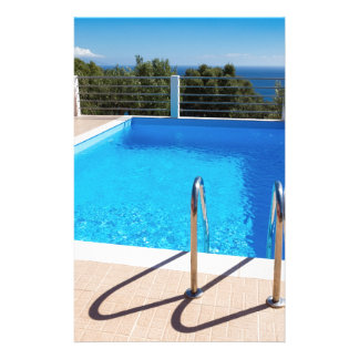 Blue swimming pool with steps at sea stationery