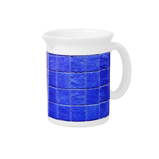 Blue tiles background pitcher