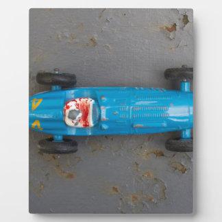 Blue toy car plaque
