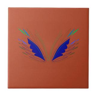 Blue wings on brown tile