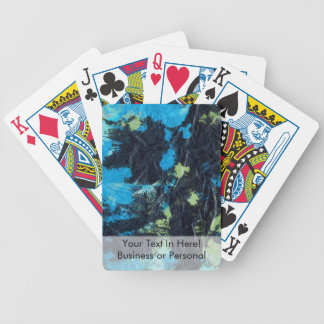 blue yellow black wrinkled paper towel bicycle poker cards
