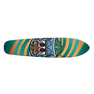 Blue zombie monkey on orange green stripes skate board deck