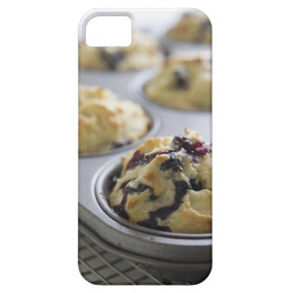 Blueberry muffins in a baking tin on a cooling iPhone 5 cover