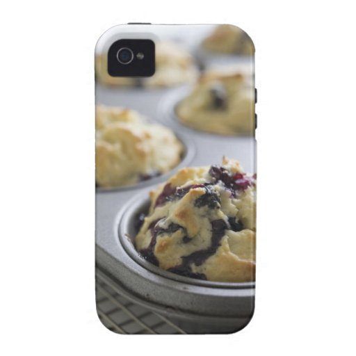 Blueberry muffins in a baking tin on a cooling Case-Mate iPhone 4 cases