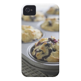 Blueberry muffins in a baking tin on a cooling Case-Mate iPhone 4 case