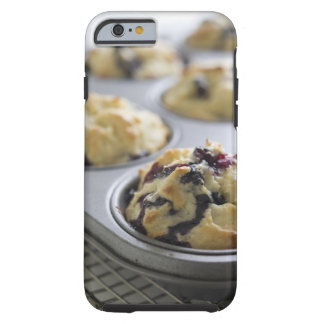 Blueberry muffins in a baking tin on a cooling tough iPhone 6 case