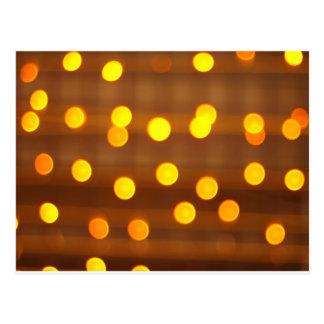 Blur image of yellow round light bulb postcard