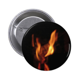 Blurred flames in a burning fireplace on black 6 cm round badge