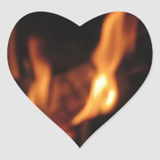 Blurred flames in a burning fireplace on black heart sticker