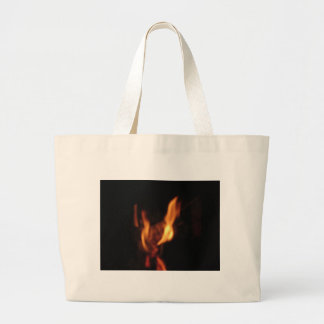 Blurred flames in a burning fireplace on black large tote bag