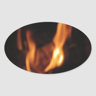 Blurred flames in a burning fireplace on black oval sticker