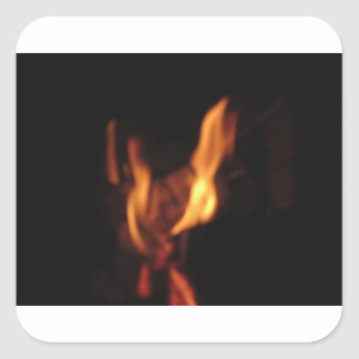 Blurred flames in a burning fireplace on black square sticker