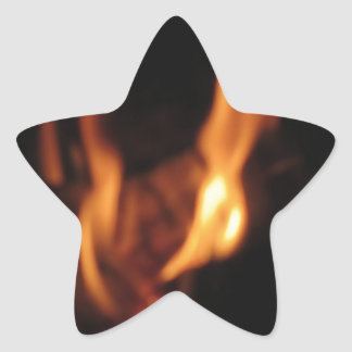 Blurred flames in a burning fireplace on black star sticker