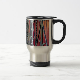 Blurred fragment of an ancient building travel mug