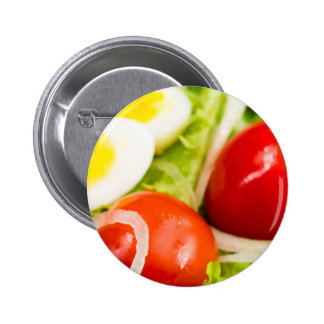 Blurred image of cherry tomatoes in a salad 6 cm round badge