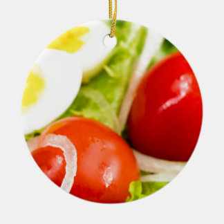 Blurred image of cherry tomatoes in a salad ceramic ornament