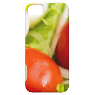 Blurred image of cherry tomatoes in a salad iPhone 5 cover