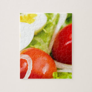 Blurred image of cherry tomatoes in a salad jigsaw puzzle