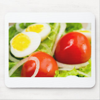 Blurred image of cherry tomatoes in a salad mouse pad