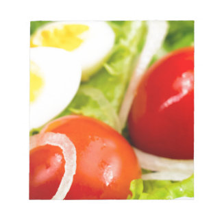 Blurred image of cherry tomatoes in a salad notepad