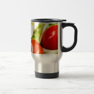 Blurred image of cherry tomatoes in a salad travel mug