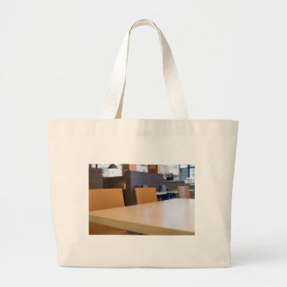 Blurred image of the interior cafe large tote bag