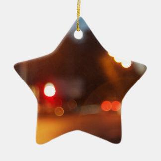 Blurred lights of cars ceramic star decoration