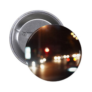 Blurred out of focus lights from cars in a night 6 cm round badge