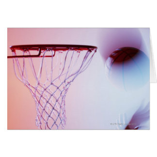Blurred view of basketball going into hoop greeting card