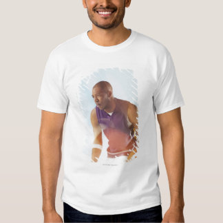 Blurred view of basketball player dribbling 2 tees