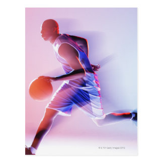 Blurred view of basketball player dribbling postcard