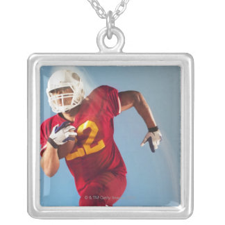 Blurred view of football player running with necklaces