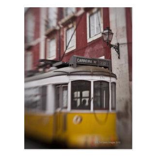 Blurred view of streetcar on city street postcard